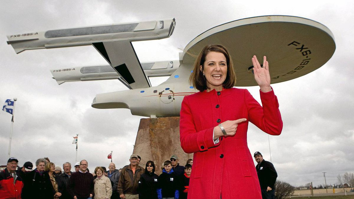 Wildrose leader Danielle Smith shows she can give a Vulcan salute as she stands in front of a model of the Starship Enterprise while making a campaign stop in Vulcan, Alta., Friday, April 6, 2012. Albertans go to the polls on April 23.