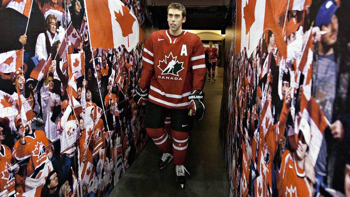 Team Canada's assistant captain Brandon Gormley walks to the ice at the Canadian national junior hockey team practice in Edmonton, Sunday Dec. 25, 2011.