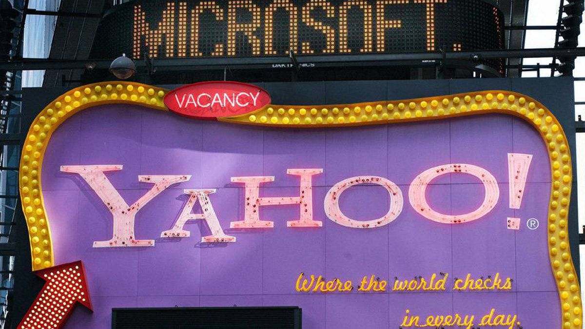 In this May 4, 2007 file photo of Times Square news ticker flashes a headline about Microsoft above a billboard for Yahoo in New York. Microsoft Corp. appears to have finally locked up rival Yahoo Inc. in a long-awaited Internet search partnership aimed at narrowing Google Inc.'s commanding lead in the most lucrative piece of the online advertising market.