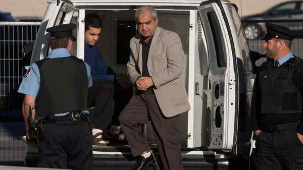 Mohammad Shafia and Hamed Shafia step out from the police van at the Frontenac county courthouse in Kingston, Ont., on Monday Nov. 21, 2011.