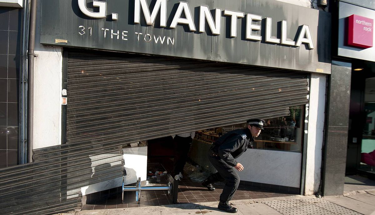 "A damaged jewellery store is pictured in Enfield, north London, following a second night of disturbances in London, on August 8, 2011. Police said Monday they had arrested 100 people in a second night of rioting in London, condemning it as ""copycat"" disorder following weekend unrest sparked by the death of a man in a police shooting. As violence which rocked the multi-ethnic northern district of Tottenham on Saturday spread to other districts of the capital, doubts emerged over the original version the shooting of 29-year-old Mark Duggan, with suggestions that officers were not under attack when they opened fire. AFP PHOTO / Ki Price (Photo credit should read Ki Price/AFP/Getty Images)"