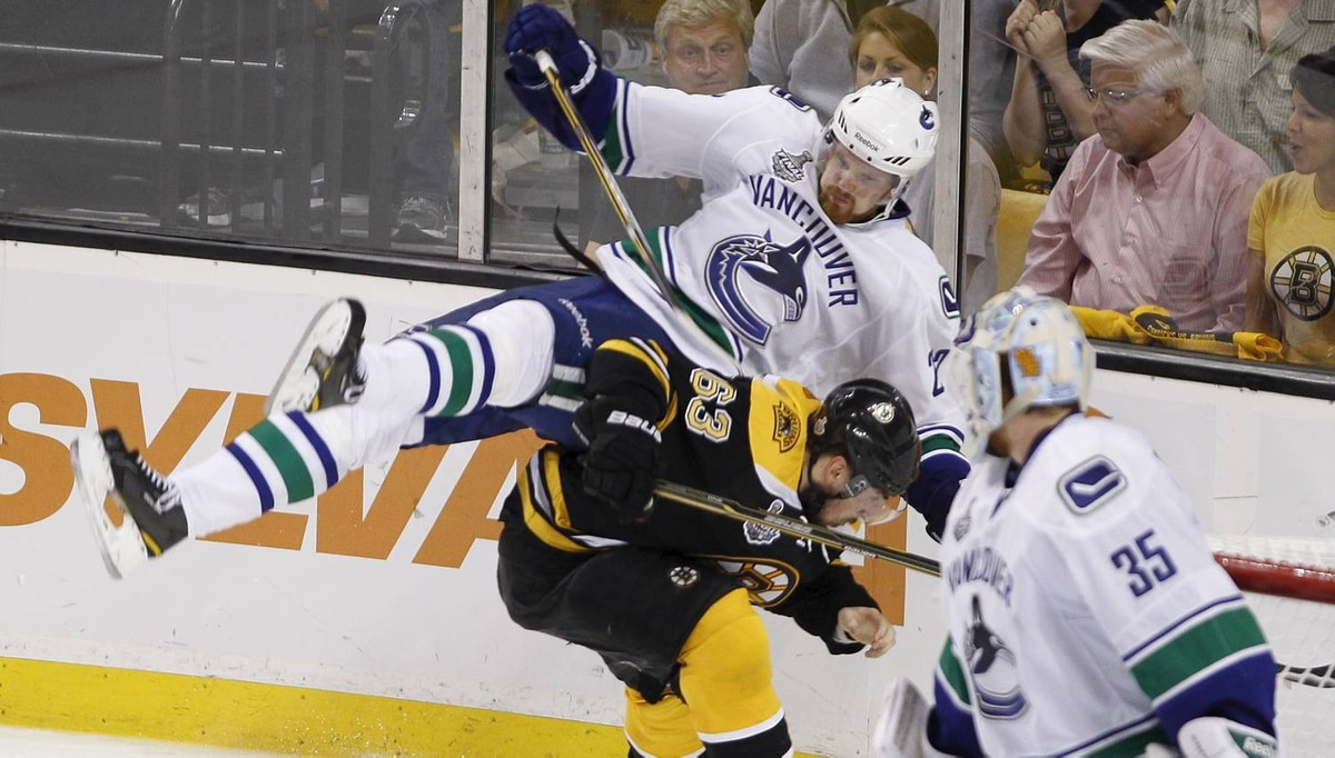Boston Bruins Brad Marchand ducks under Vancouver Canucks Daniel Sedin during the third period of Game 4 of the NHL Stanley Cup Final series between the Boston Bruins and the Vancouver Canucks in Boston on June 8, 2011. The Bruins won 4-0, with Boston Bruins Tim Thomas getting a shut-out and a slashing minor. (Photo by Peter Power/The Globe and Mail)
