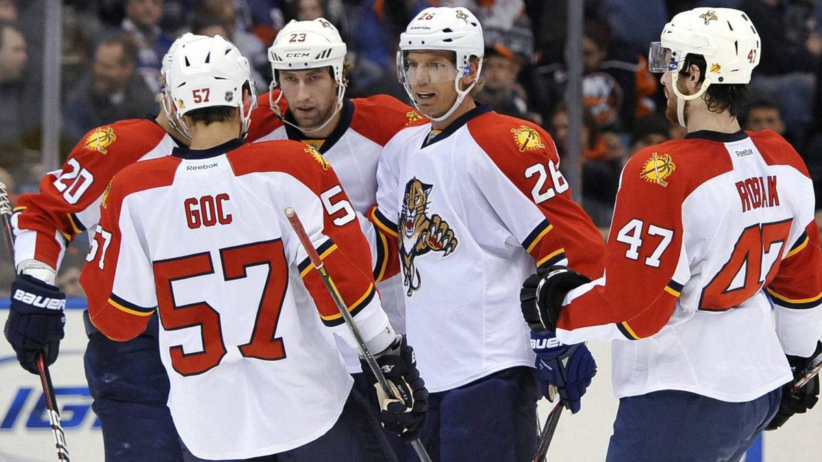 Florida Panthers' Marcel Goc (57), Sean Bergenheim (20), Tyson Strachan, Mikael Samuelsson (26) and Colby Robak (47) celebrate Strachan's goal against New York Islanders goalie Evgeni Nabokov in the first period of an NHL hockey game on Sunday, Feb. 12, 2012, in Uniondale, N.Y. The Panthers won 4-1. (AP Photo/Kathy Kmonicek)