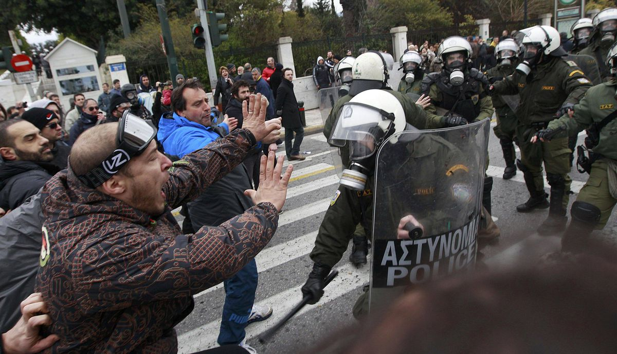 Demonstrators confront riot police during protests against planned reforms by Greece's coalition government in Athens, February 10, 2012.
