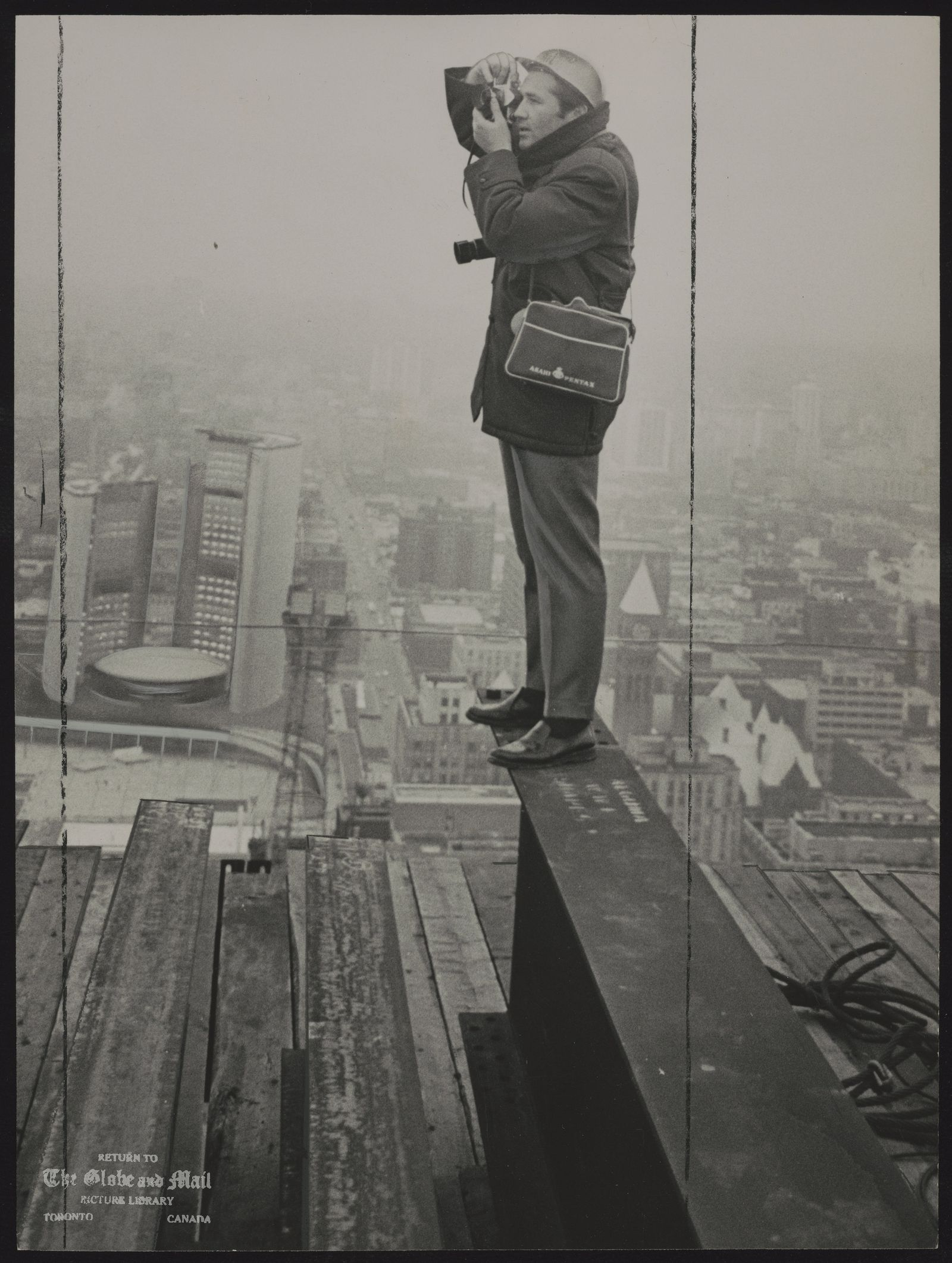 Boris SPREMO Globe and Mail photographer perches on girder at Toronto Dominion Centre to take another view from the top.