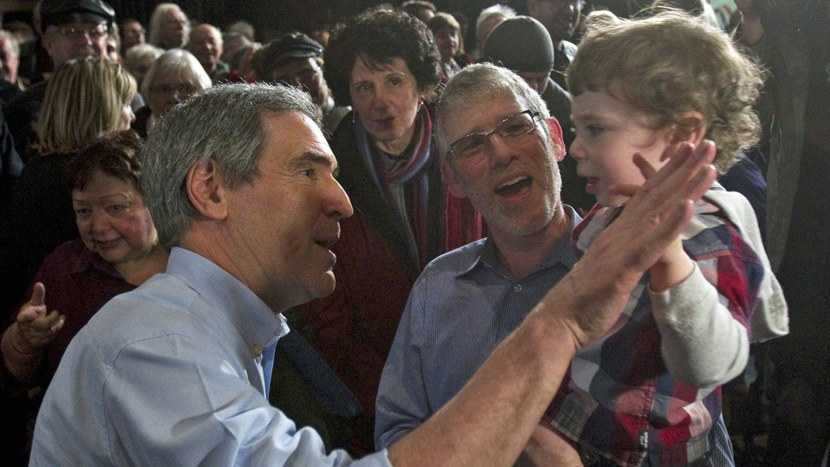 Liberal Leader Michael Ignatieff gets a high five from Avie Brodeur at a town hall meeting in Winnipeg on March 30, 2011.