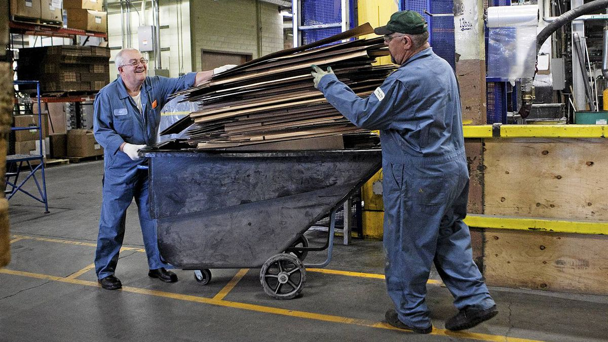 Workers pile cardboard for recycling at Tremco in Toronto. Tremco is attempting to achieve zero waste going to landfill by recycling plastics, metal, wood and cardboard.