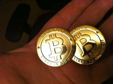 As value soars, digital currency Bitcoin attracts offline attention