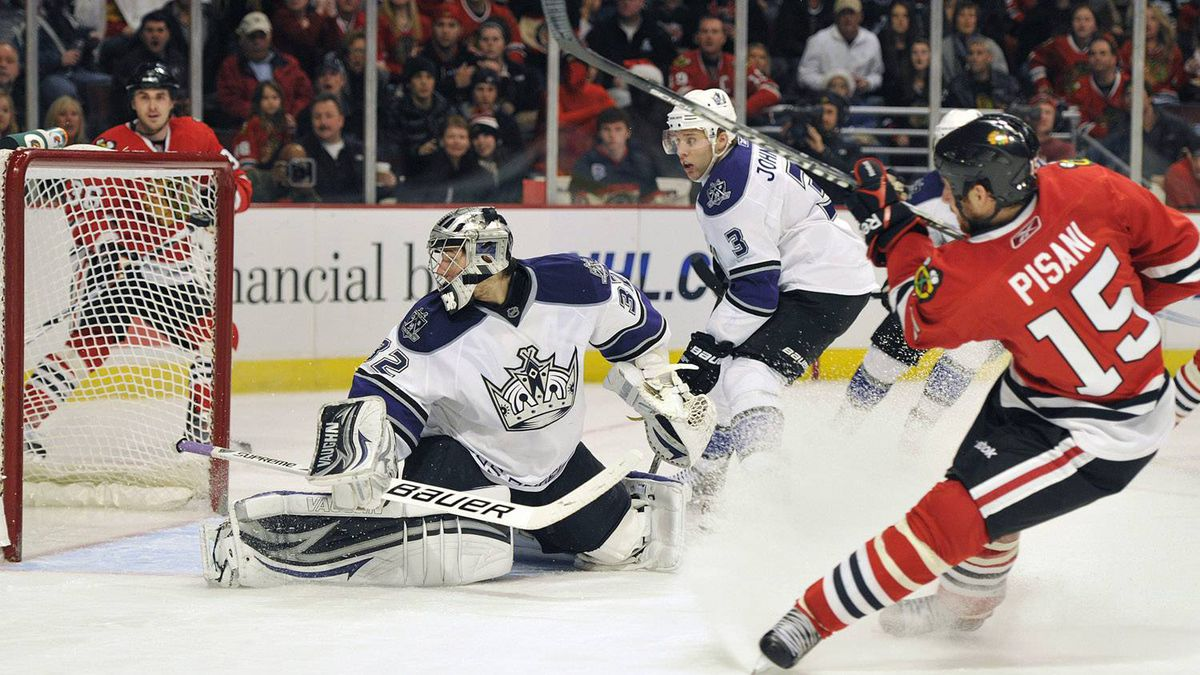 Los Angeles Kings goalie Jonathan Quick watches the puck go into the net on a goal by Chicago Blackhawks' Fernando Pisani (15) during the second period of an NHL hockey game Sunday, Dec. 19, 2010, in Chicago. The Blackhawks won 3-2. (AP Photo/Jim Prisching)