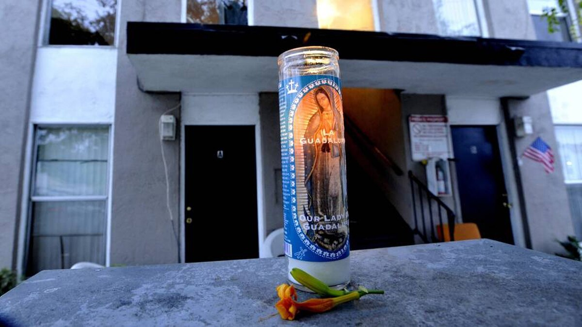 A memorial candle sits outside the Buena Park, Calif., apartment complex on Aug. 19 where the body of a model from Los Angeles, Jasmine Fiore, 28, was placed in a dumpster.