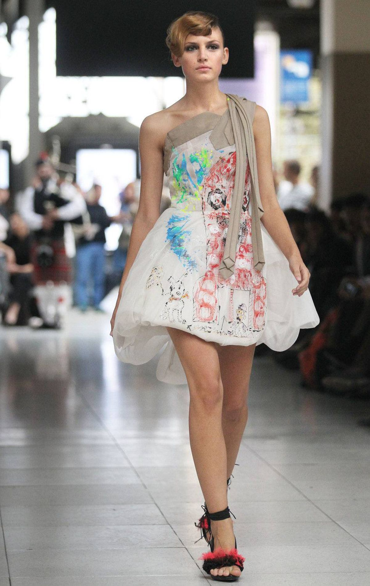 A model presents a creation by French designer Karim Bonnet for Impasse de la Defense during the spring/summer 2012 ready-to-wear collection show, on October 5, 2011 at the Austerlitz Train Station in Paris.