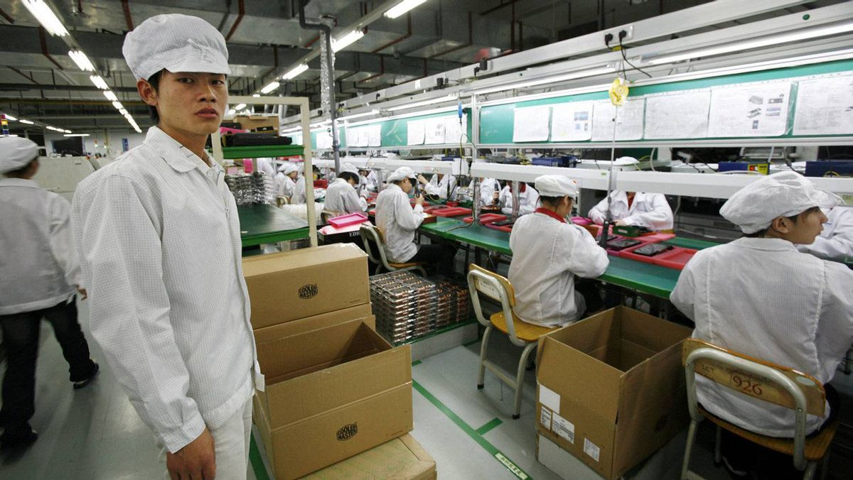 Workers inside a Foxconn factory in the township of Longhua in southern Guangdong province