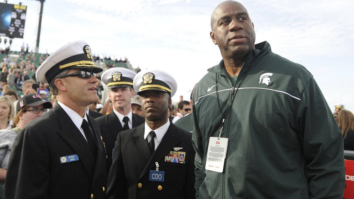 Former Michigan State Spartans player Magic Johnson talks with Navy officials prior to the game game against North Carolina Tar Heels during at the Carrier Classic on board USS Carl Vinson. Christopher Hanewinckel-US PRESSWIRE