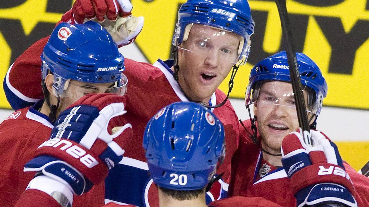 Montreal Canadiens' Brendon Nash, centre, celebrates with teammates Max Pacioretty, left, David Desharnais, right, and Ryan O'Bryne after scoring against the Minnesota Wild during second period pre-season NHL action in Montreal, Sunday, Sept. 26, 2010. THE CANADIAN PRESS/Graham Hughes