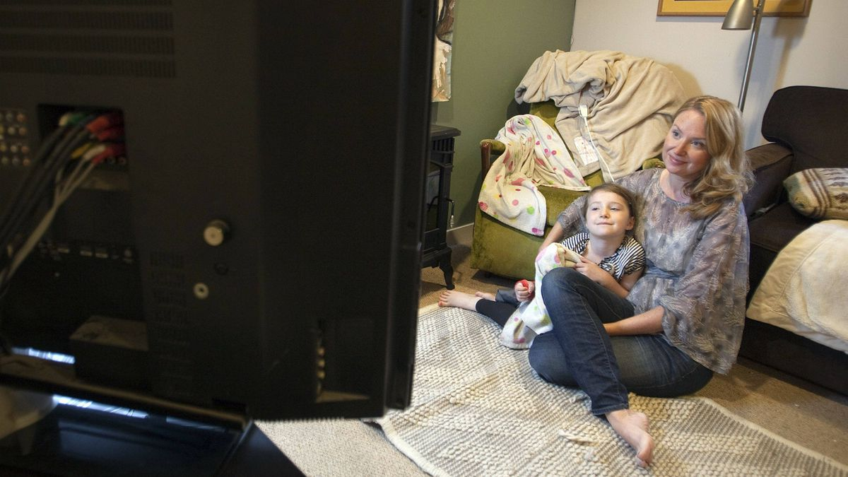 Laura Barker and her 5 year old daughter Veronica watch television in their home in Vancouver.