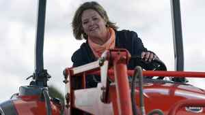 Ontario NDP Leader Andrea Horwath gets behind the wheel of a tractor during a campaign stop at the International Plowing Match in Chute-a-Blondeau on Sept. 20, 2011.