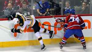 Boston Bruins right wing Nathan Horton (18) falls after battling for the puck against Montreal Canadiens defenseman Alexei Emelin (74) and captain Brian Gionta (21) during the first period at the Bell Centre.