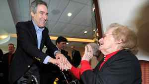 Liberal Leader Michael Ignatieff greets a senior during a campaign stop in Laval, Que., on Thursday morning, April 7, 2011