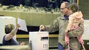 A voter casts his ballot for the federal election at a polling station in Ottawa on May 2 , 2011.