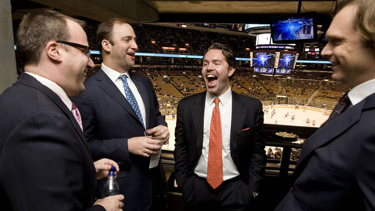 Ice Edge Holdings chairman Keith McCullough, second from right, laughs while joking with partners, from left to right, CEO Anthony LeBlanc, COO Daryl Jones, and CFO Todd Jordan in a suite at the ACC during NHL regular season action between the Phoenix Coyotes and Toronto Maple Leafs on December 16, 2009.