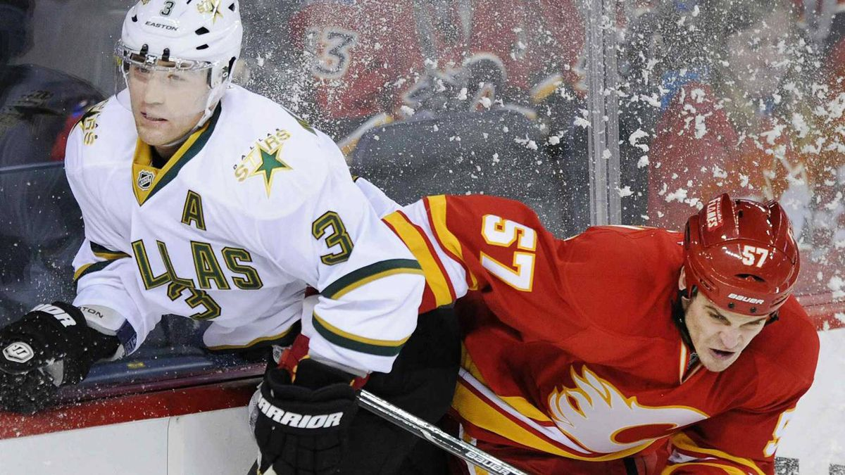Calgary Flames' Lance Bouma (57) hits Dallas Stars' Stephane Robidas during the first period of their NHL hockey game in Calgary, Alberta March 4, 2012. REUTERS/Mike Sturk