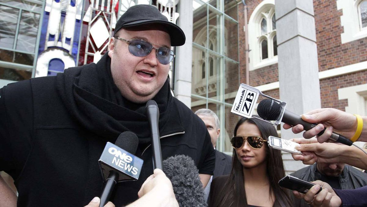Megaupload founder Kim Dotcom stands next to his wife Mona as he talks to members of the media after he left the High Court in Auckland February 29, 2012.