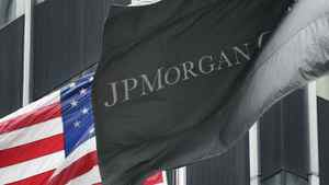 The corporate flag for JPMorgan Chase flies at corporate headquarters, Monday, May 14, 2012 in New York.