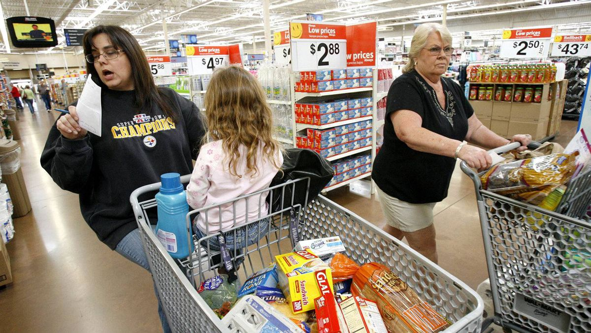 Grocery shoppers at a Wal-Mart store in Santa Clarita, Calif.