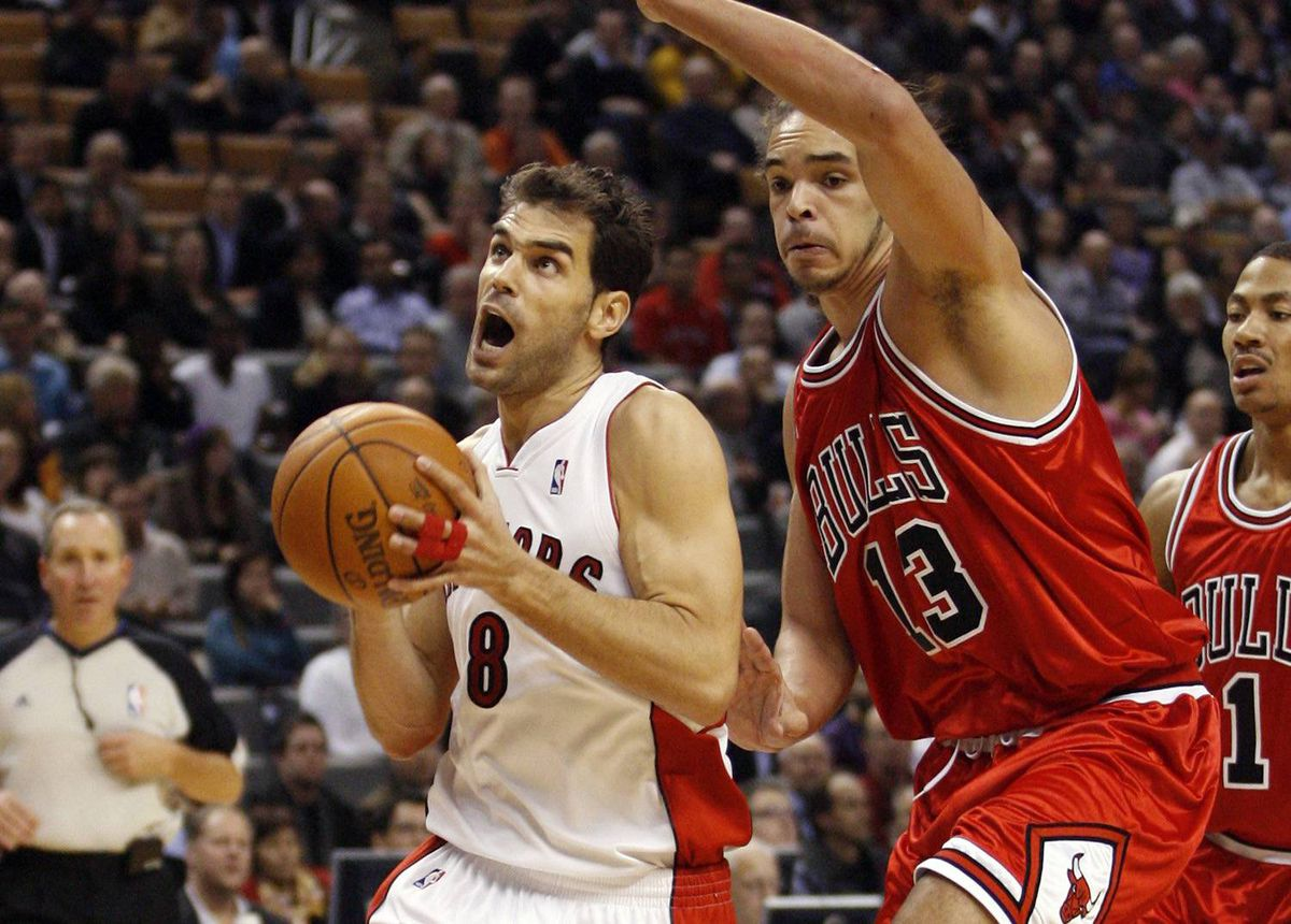 Toronto Raptors guard Jose Calderon goes to the basket past Chicago Bulls forward Joakim Noah, right, during the first half of their NBA basketball game in Toronto, November 11, 2009.