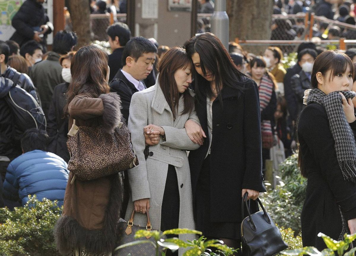 Evacuees stand around Shinjuku Central Park in Tokyo on March 11, 2011.