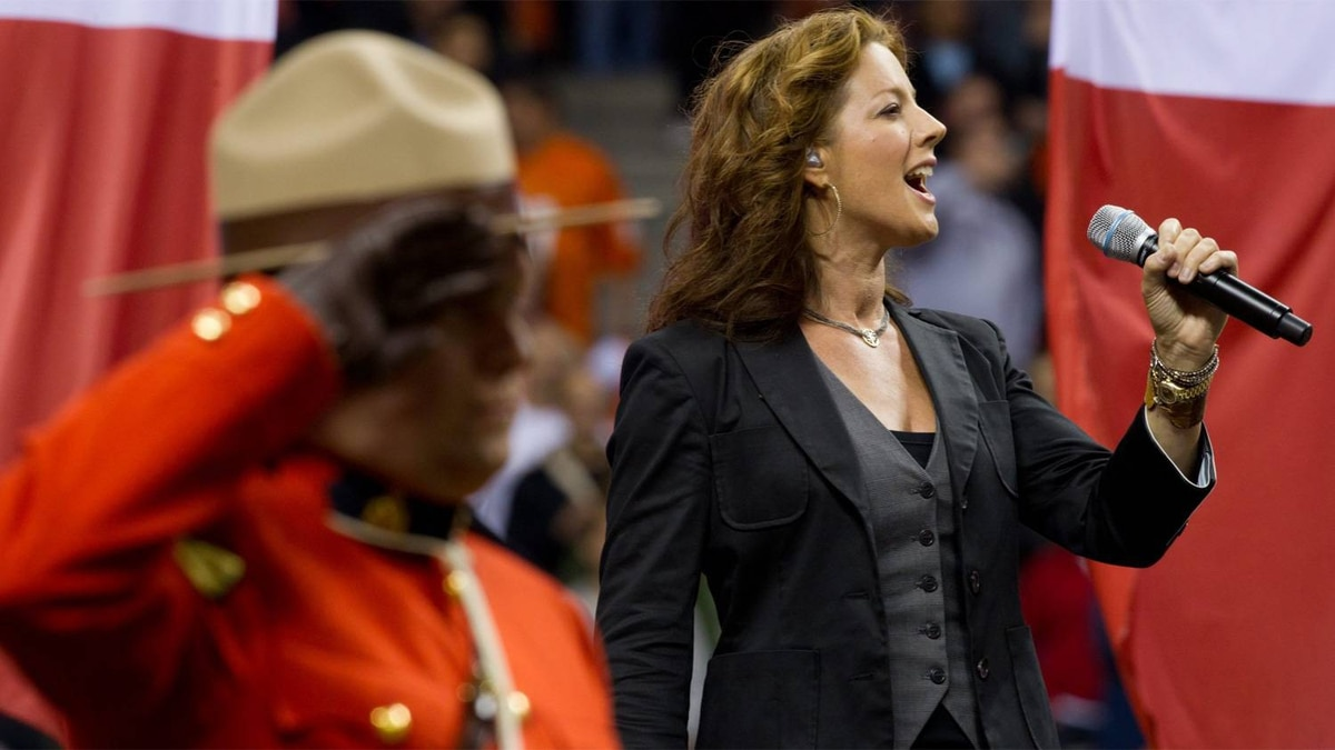 Canadian singer Sarah McLachlan sings the national anthem at the renovated B.C. Place stadium before the B.C. Lions and Edmonton Eskimos CFL football game in Vancouver, B.C., on Friday September 30, 2011.