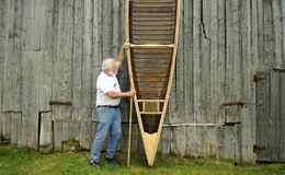 Bill Miller stands up his very first completed canoe. Built in the 1960s, and Mr. Miller being 15 at the time, he along with his grandfather William Victor Miller built the canoe as a project while the summer rain kept them inside from their chores.