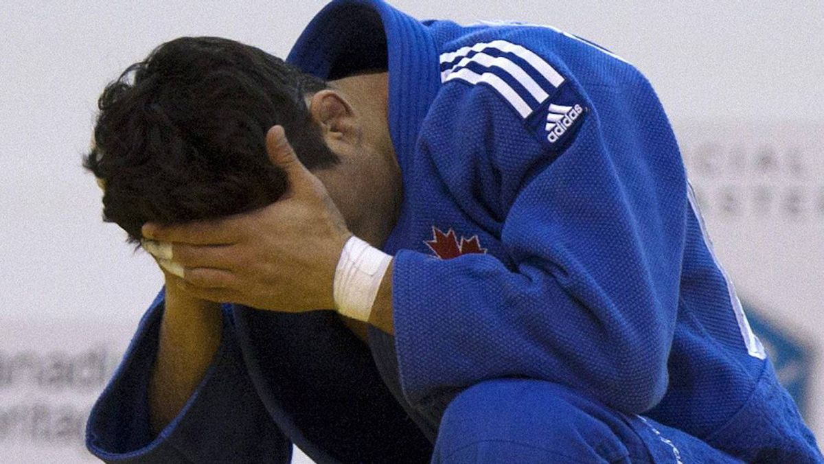 Canada's Sergio Pessoa reacts after losing to Brazil's Felipe Kitadai in their under 60kg final match at the Pan American Judo Championship in Montreal April 28, 2012. REUTERS/Olivier Jean