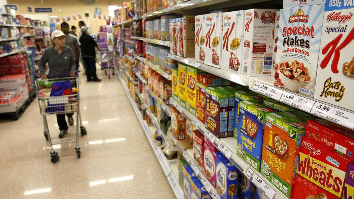 Customers shop for groceries in a supermarket in London October 18, 2011.
