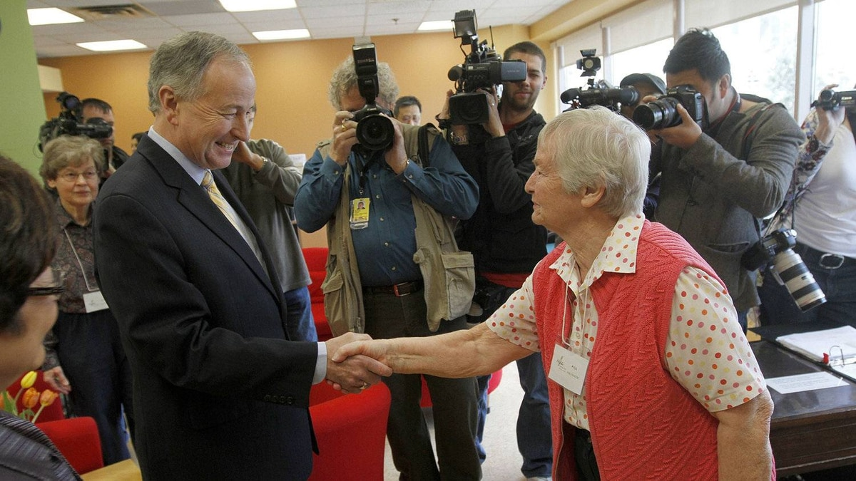 Justice Minister Rob Nicholson shakes hands with Anja Rautiainen, a volunteer at North York Seniors Center during a visit to announce the introduction of legislation that will see tougher sentences for those convicted of elder abuse. Toronto March 15 2012.