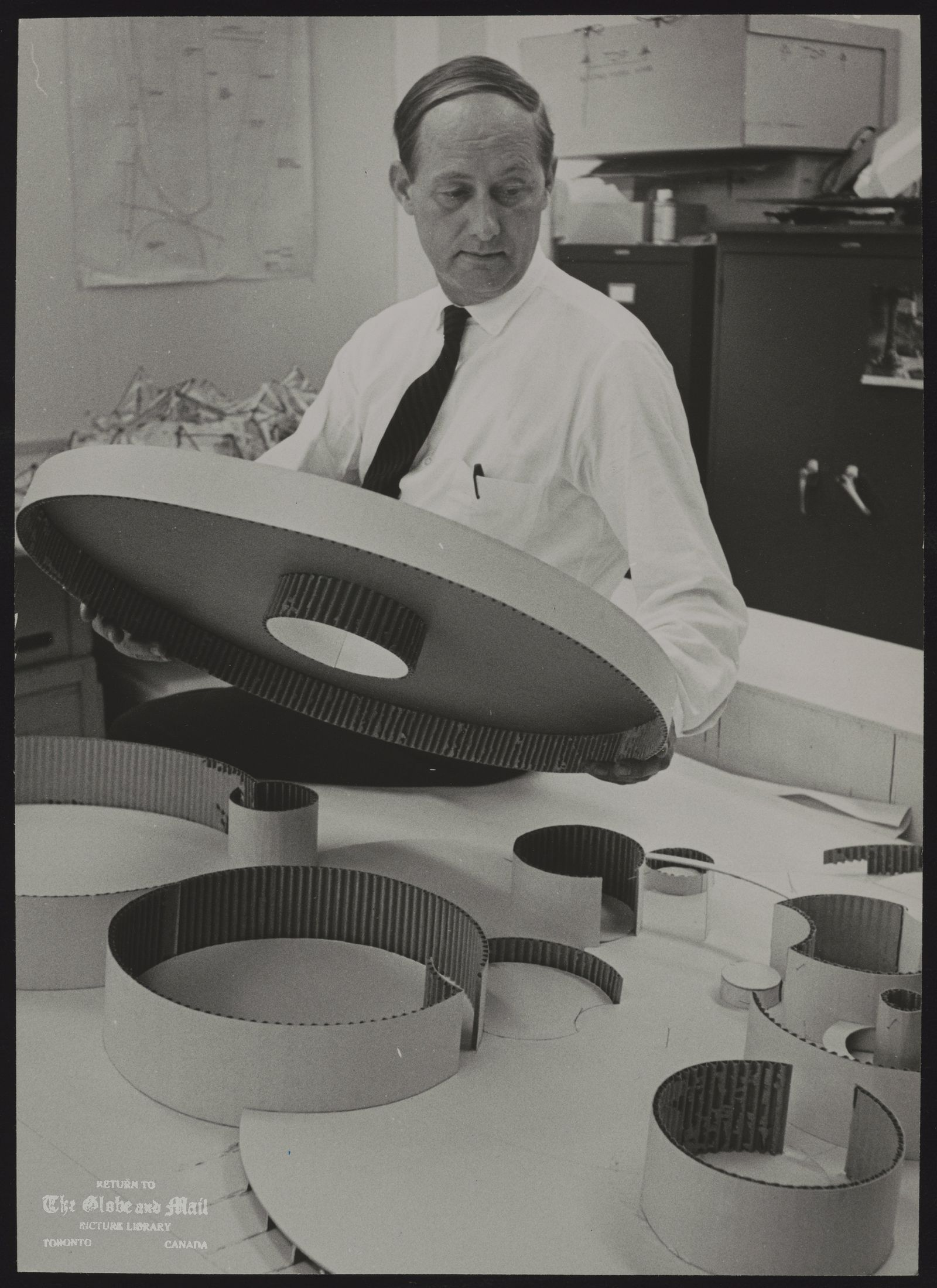 Robert FAIRFIELD Toronto. Architect Stratford Theatre designer Robert Fairfield, works on model for industrial pavilion for Expo' 67.