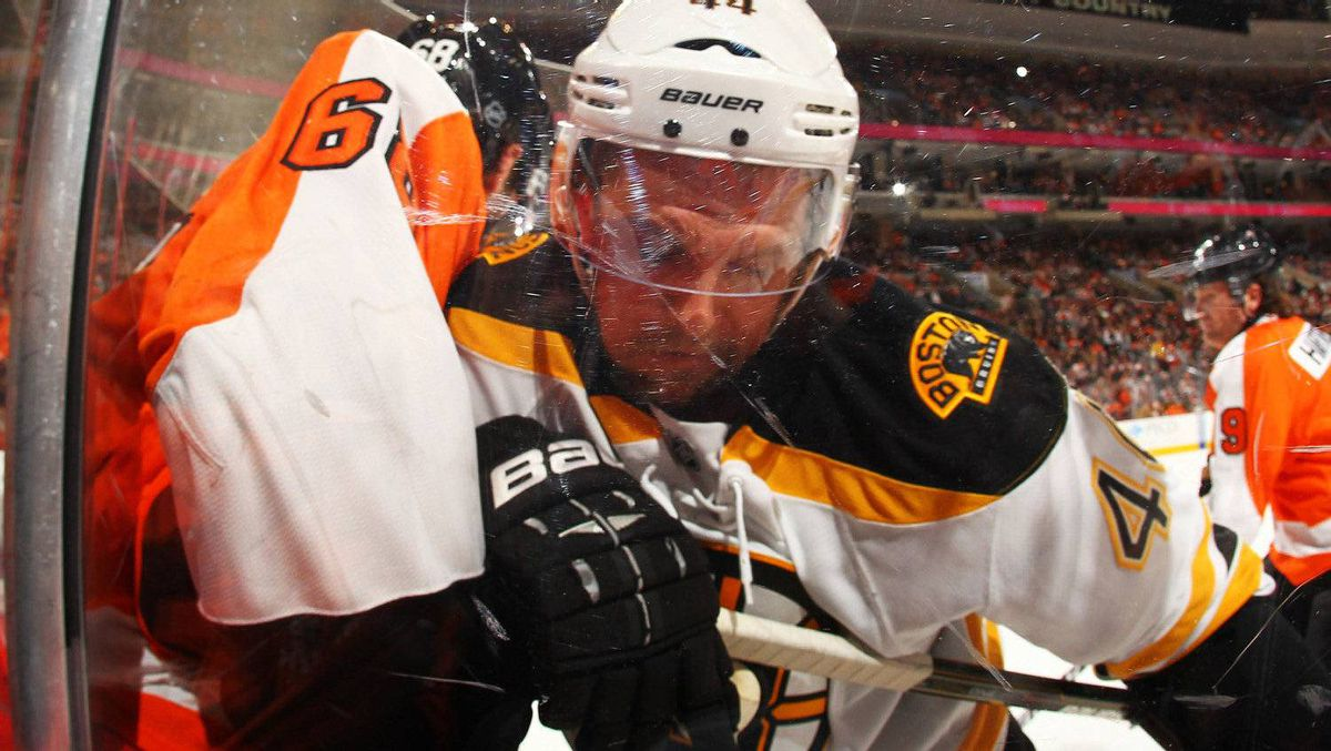 Dennis Seidenberg #44 of the Boston Bruins checks Jaromir Jagr #68 of the Philadelphia Flyers during their game on December 17, 2011 at The Wells Fargo Center in Philadelphia, Pennsylvania. The Bruins won 6-0. (Photo by Al Bello/Getty Images)