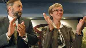 Deputy leader Thomas Mulcair and Interim Leader Nycole Turmel applaud during the NDP's summer caucus retreat in Quebec City on Sept. 14, 2011.