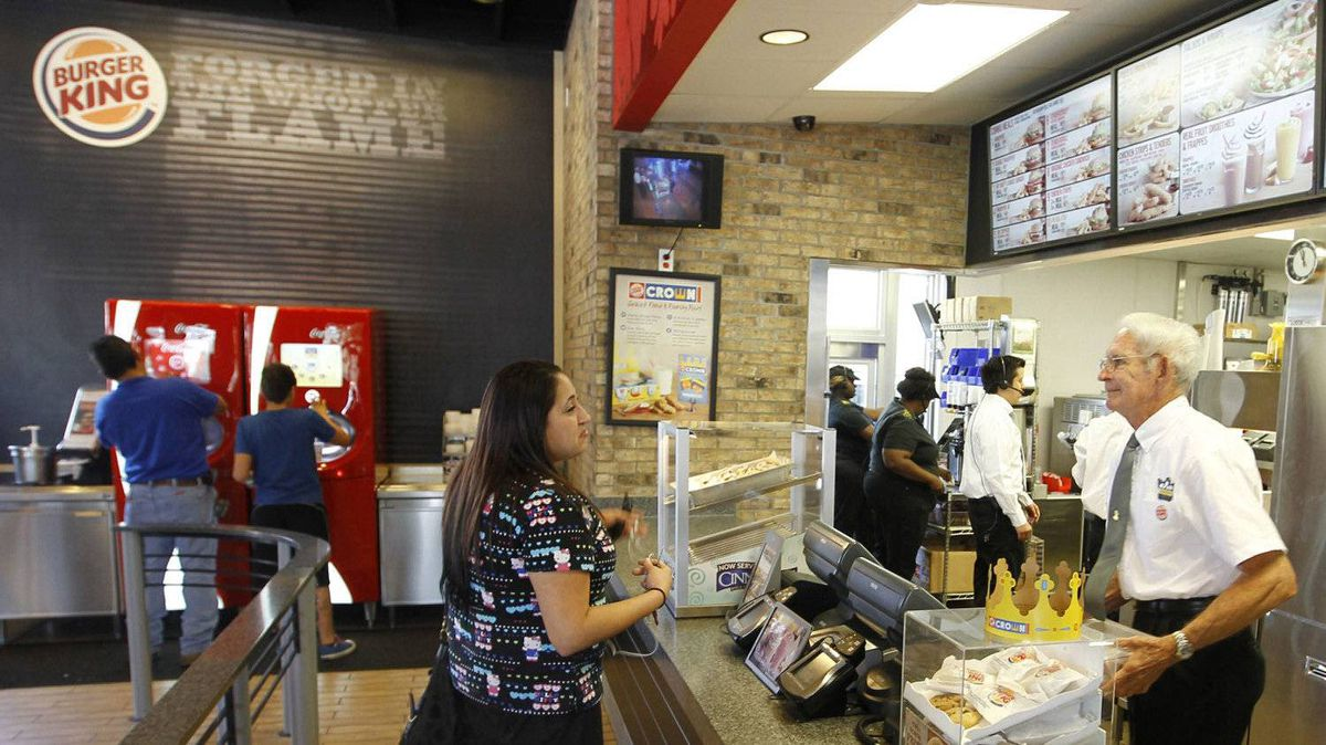 A customer orders food at a Burger King restaurant in Miami.
