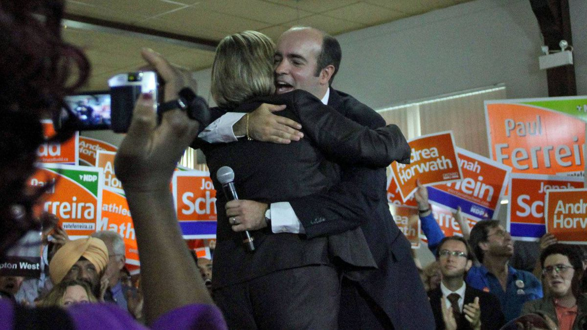 NDP candidate Paul Ferreira greets Leader Andrea Horwath at a campaign rally in the Toronto-area riding of York South-Weston on Sept. 7, 2011.