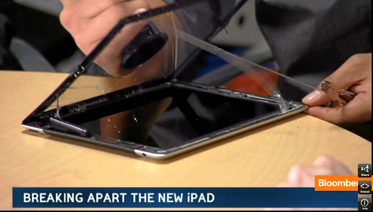 """When a heavy-duty suction cup and utility knives can't beat Apple's industrial-strength adhesives, the wrecking crew resorts to a heat gun. """"The secrets of the iPad are well-hidden by Apple,"""" Mr. Johnson says in a voiceover."""