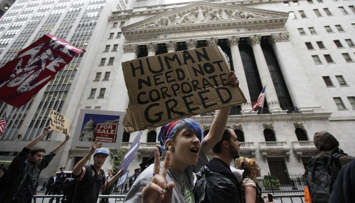 Protesters from the Occupy Wall Street campaign march in front of the New York Stock Exchange in New York September 28, 2011.