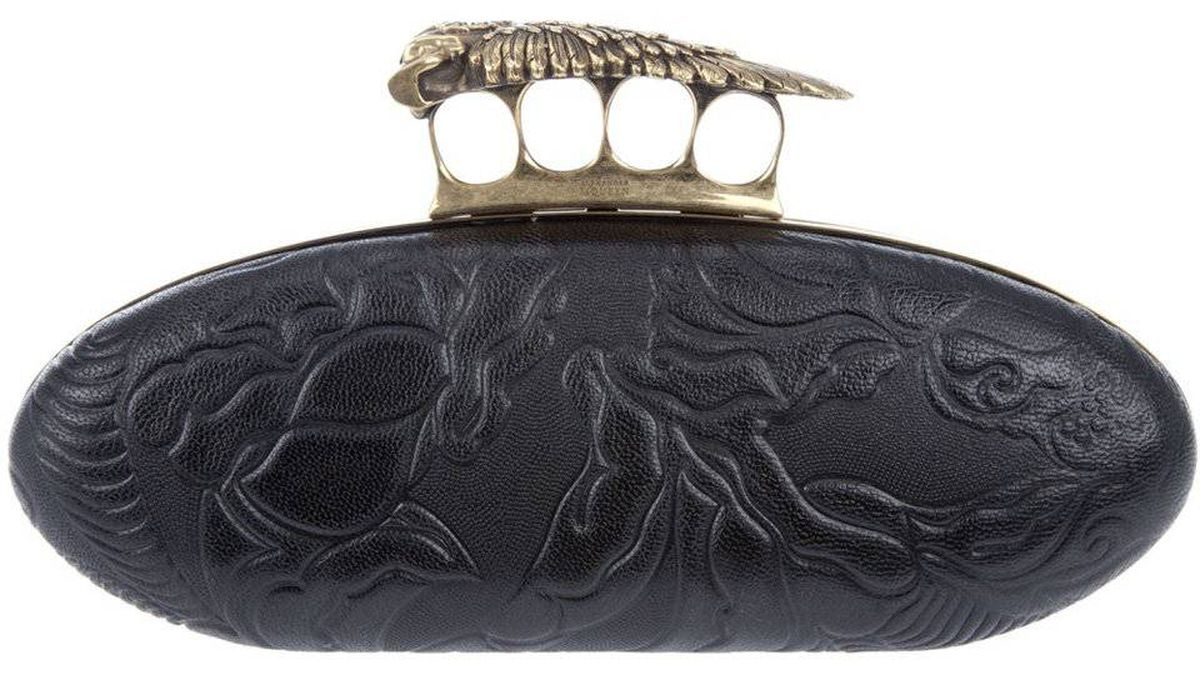 The Hells Knuckle Duster? clutch purse by Alexander McQueen, listed for Eur 1, 370.00 on farfetch.com.