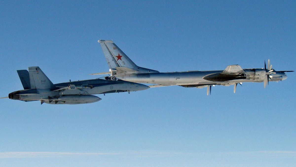 This undated file photo provided by the U.S. Air Force shows a Canadian Air Force F-18 Hornet jet escorting a Russian TU-95 Bear heavy bomber out of Canadian airspace.
