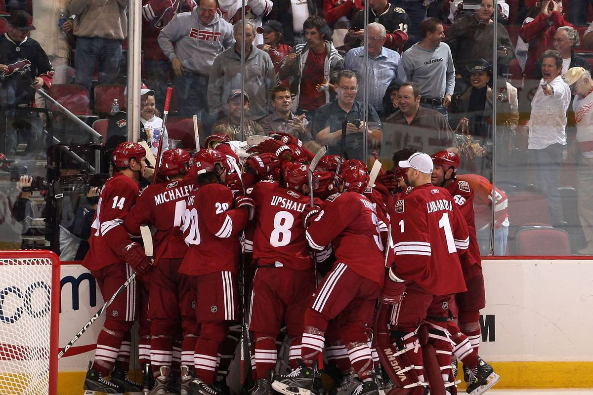 The Phoenix Coyotes celebrate after Adrian Aucoin scored the game-winning goal in overtime against the Detroit Red Wings at the Jobing.com Arena on Oct. 22.