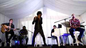 Somali-Canadian hip-hop artist K'naan performs with his band. He played a song about a girl he once knew who after died because of violence in Somalia.