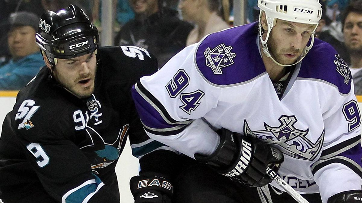 Ryan Smyth #94 of the Los Angeles Kings is defended by Ian White #9 of the San Jose Sharks in game five of the Western Conference Quarterfinals during the 2011 NHL Stanley Cup Playoffs at HP Pavilion on April 23, 2011 in San Jose, California. (Photo by Ezra Shaw/Getty Images)