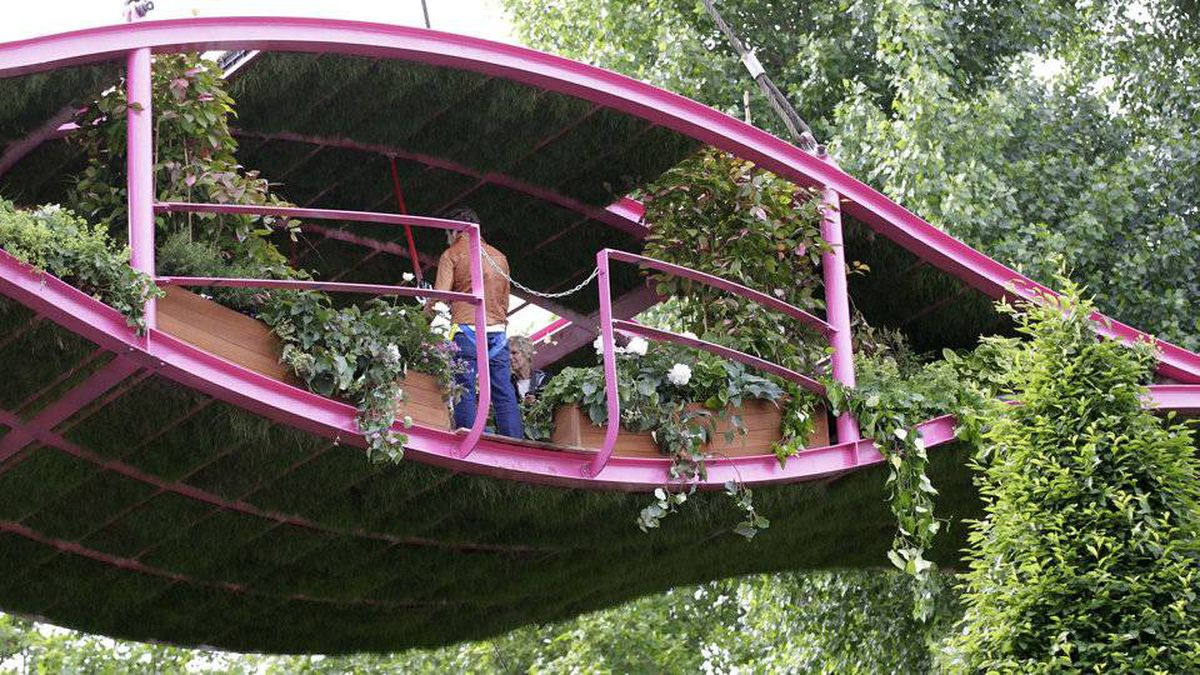 Gardeners are seen in the Irish Sky Garden at the Chelsea Flower Show in London, Monday, May 23, 2011. The show garden is inspired by Dublin animator Richie Baneham who created the visual effects work in Avatar.