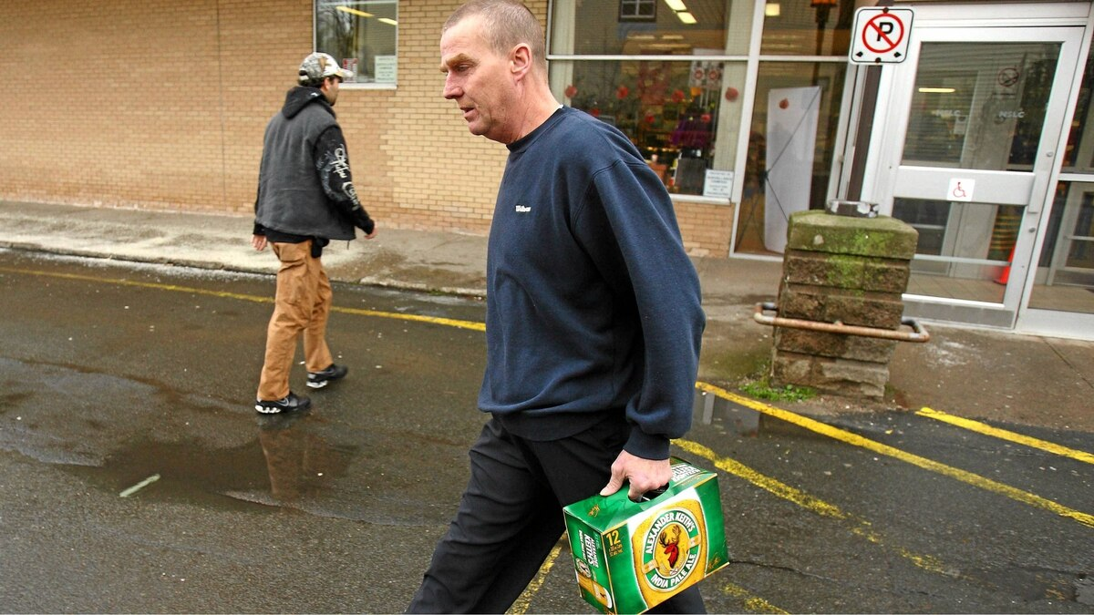 Darrell Johnson leaves with a case of Alexander Keith's beer at the Nova Scotia Liquor Commission store on Agricola street in Halifax, NS, November 23, 2010. Plans to move some of the Keith's brand products will result in the loss off full-time and temporary jobs.