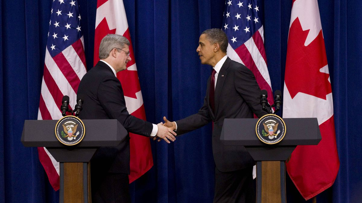 Prime Minister Stephen Harper shakes hands with U.S. President Barack Obama after taking part in a joint press conference in the Eisenhower Executive Office Building across from the White House in Washington on Feb. 4, 2011.